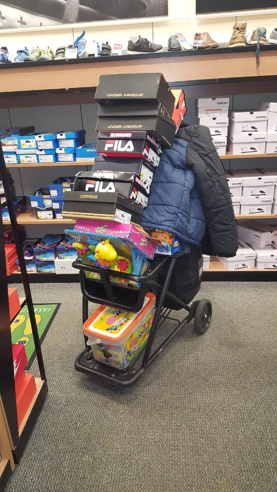Teacher at Kohl's buying gifts for penny wars.jpg