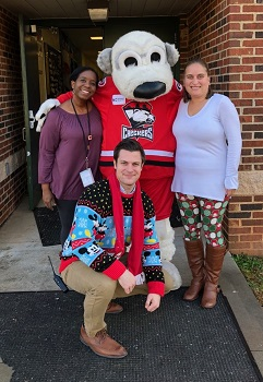 Photo of Grade 5 teachers Ms Henry and Ms Yewcic with Assistant Principal Mr Maleck and Chubby, the Charlotte Checkers mascot.