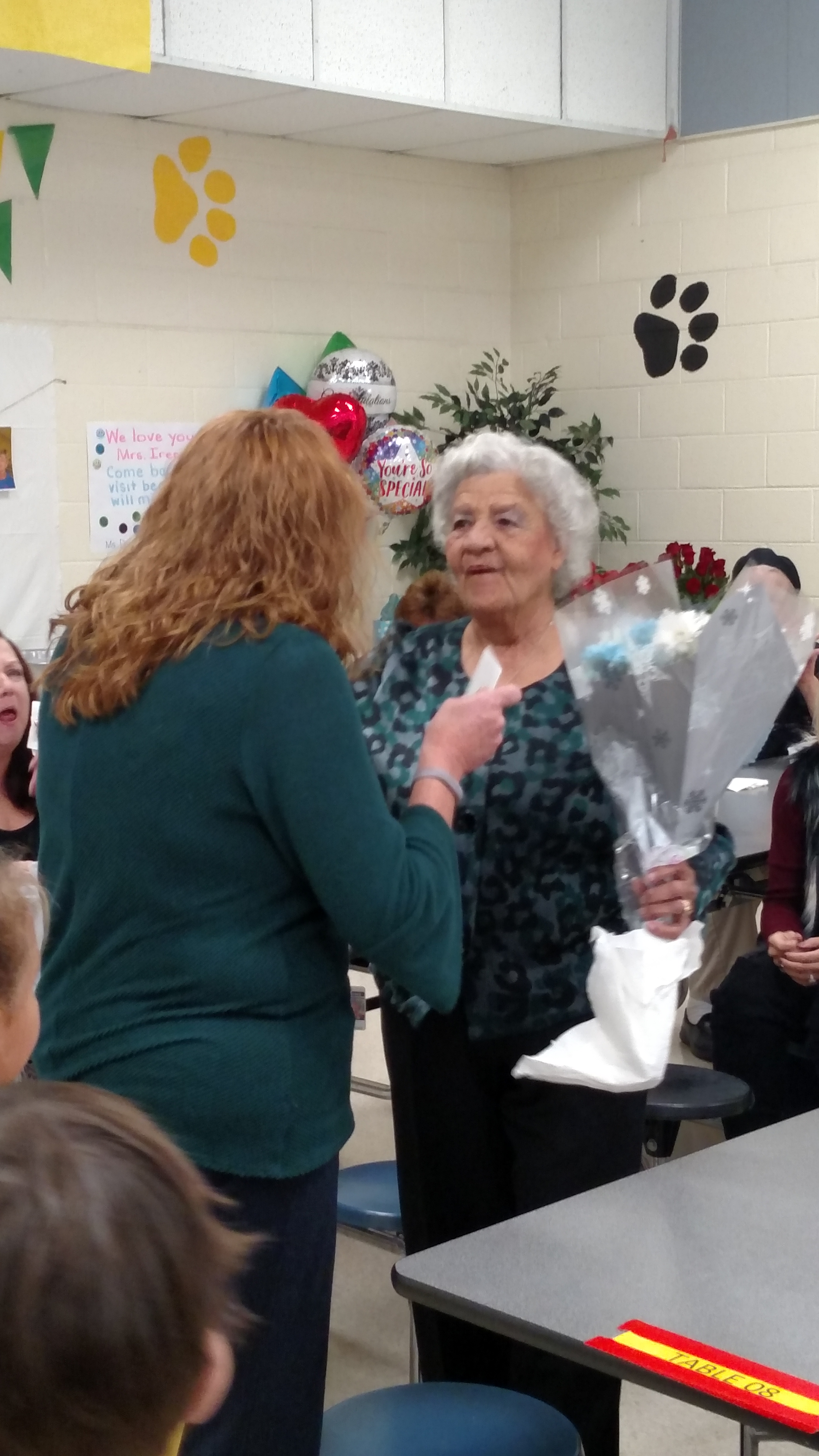 Mrs. Satink Honoring Mrs. Jamison with flowers.jpg